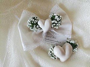 Bomboniera fiocco con cuore in ceramica e merletto cod. 80R