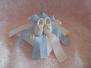 Cuscino con scarpette per vedere tutta la linea scarpette bebè visionare la linea battesimo