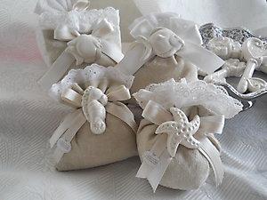 Sacchetto comunione matrimonio con stella marina e cavalluccio in ceramica cod. 50M 51M